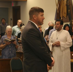 David Clegg makes a Profession of Faith in the Catholic Church at the Easter Vigil.